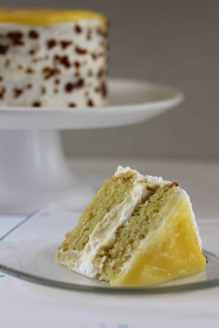 The layer of lemon curd on top isn't part of the original lemon crunch cake, but I love the hit of lemon that this version has. #lemoncake #layercake #toffee #pastrycream #whippedcream