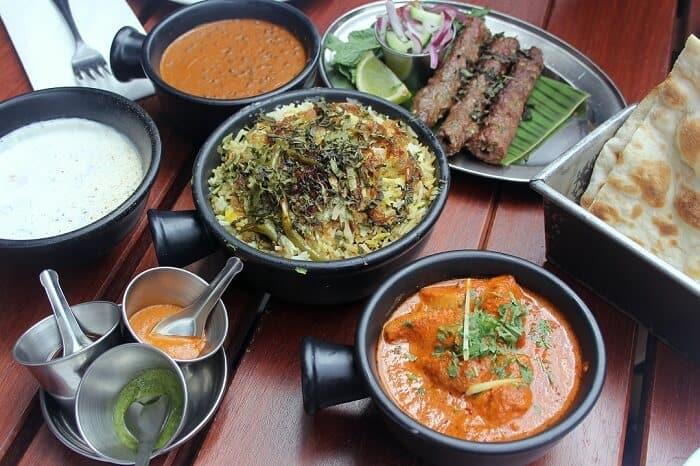 Biryani, daal, chicken korma, lamb kabobs, raita, naan and chutneys from Dishoom in London. #indianfood #london #daal #biryani #kabob #naan #chutney