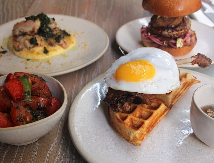 Roast duck with mashed potatoes, strawberry and tomato salad, duck and waffle, and a duck burger from Duck and Waffle in London. #london #duckandwaffle #waffles #sliders #dinnerout