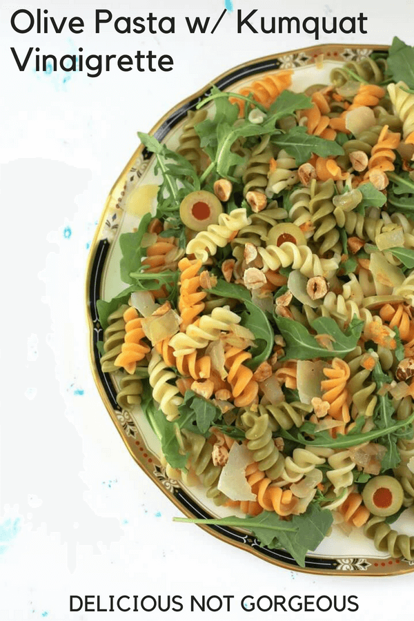 This olive pasta with kumquat vinaigrette is nice and citrusy, thanks to the lemon zest, lemon juice and minced preserved kumquat (preserved lemon works too!) in the vinaigrette. #olives #pasta #pastasalad #arugula #preservedlemon