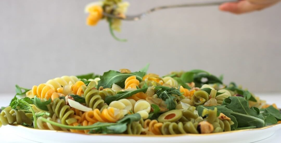 This olive pasta with kumquat vinaigrette is the kind of addictive that has you eating a bite straight from the serving dish. #olives #pasta #pastasalad #arugula #preservedlemon