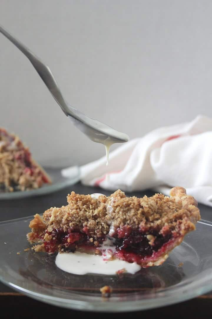You can drizzle slices of this cranberry sauce pie with creme anglaise (or melted vanilla ice cream) to mellow out the tartness of the cranberries. #cranberries #cranberrysauce #pecans #pie #thanksgiving #thanksgivingdessert