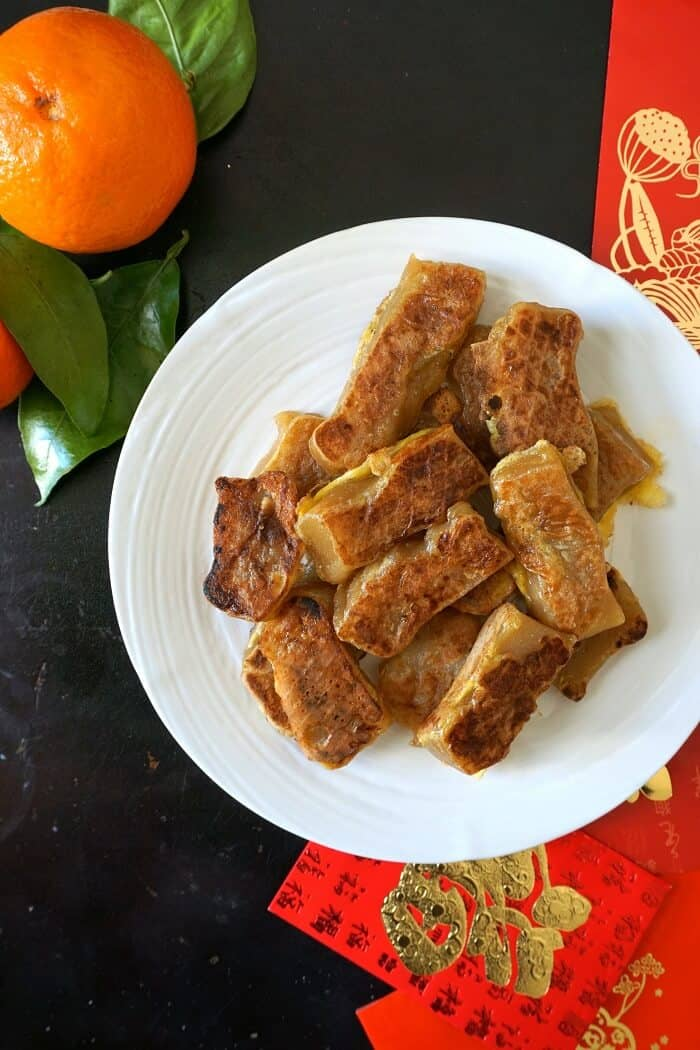 My favorite way to have nian gao (Chinese sweet rice cake for Chinese New Year) is cut up, dippen in beaten egg, and pan-fried until crispy on the outside and soft and squishy on the inside. Mmmm. #chinesenewyear #niangao #ricecake #chinesefood