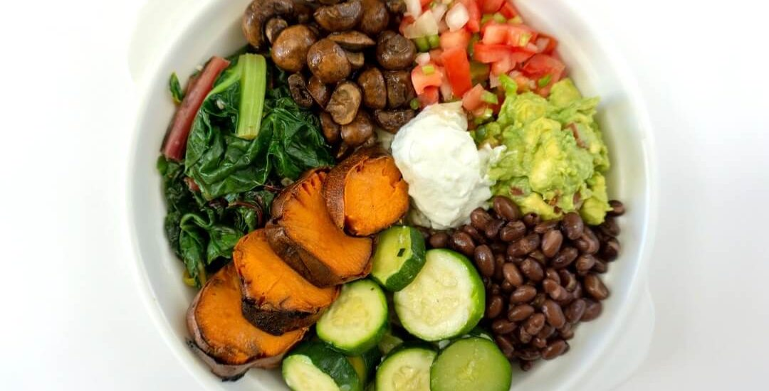 This sweet potato burrito bowl has tons of vegetables and some charred sweet potato. #sweetpotatoes #burritobowl #mexicanfood #lunchideas #mealprep