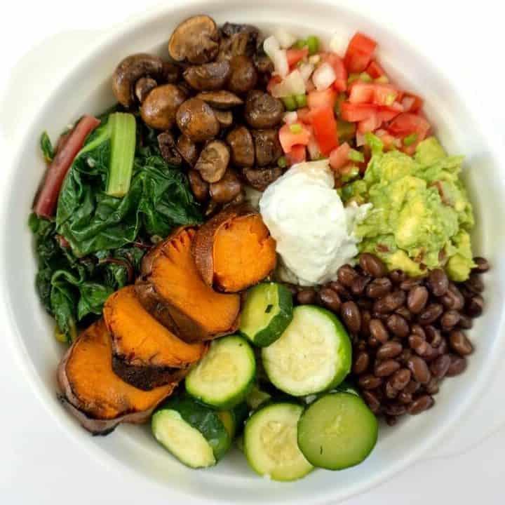 This sweet potato burrito bowl has tons of vegetables and some charred sweet potato. #sweetpotatoes #burritobowl #mexicanfood #lunchideas #mealprep
