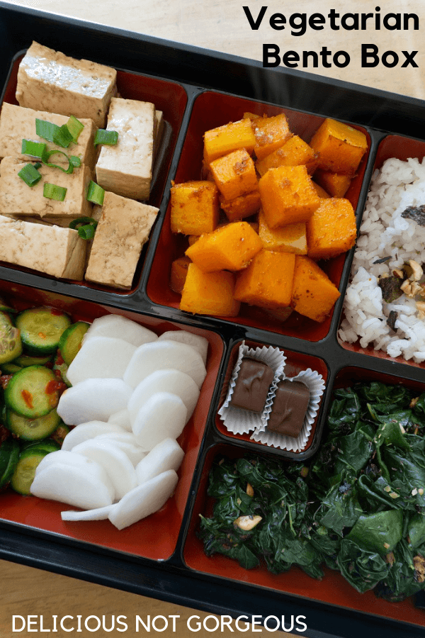 This bento box (with 4 different kinds of vegetables, tofu, rice and chocolate) is perfect for the person who likes to nibble around their plate at lunch. #bentobox #lunchideas #vegetarian