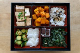 This bento box has rice, roasted squash, marinated tofu, garlicky cucumbers, pickled radish and sauteed kale, but you can definitely omit parts as you please! #bentobox #lunchideas #vegetarian