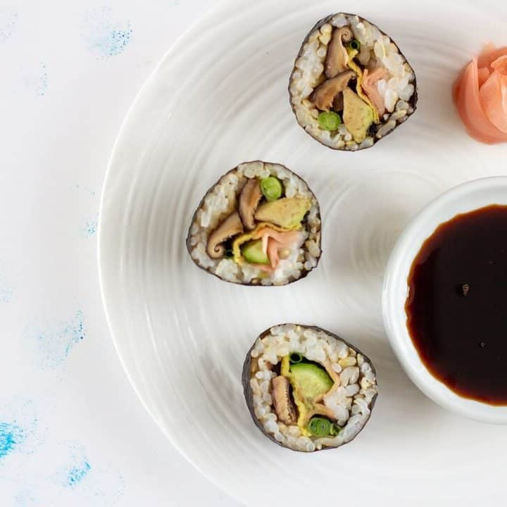 This shiitake mushroom and avocado sushi is so flavorful you could eat it plain, but a touch of soy sauce and more pickled ginger on the side doesn't hurt! #mushrooms #avocado #sushi #vegetarian