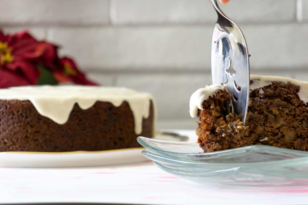 This spiced persimmon cake is richly brown, and topped with a swath of white cream cheese frosting.