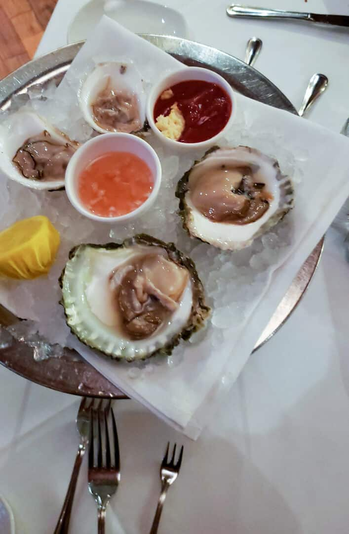 Oysters in a tray from Atlantic Fish Co. in Back Bay, Boston, MA.
