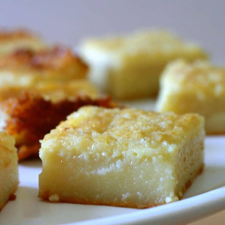Square of golden yellow mochi with crispy, crumbly top.